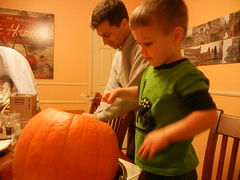Dominic pumpkin carving with Daddy