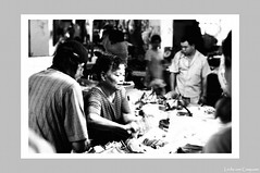 A busy vendor in a local market () (Leche con Compasio) Tags: people bw film taiwan hc110 vendor taipei   iso320  selfdeveloped agfaapx100   nikonf2as  traditionalmarket nikkor55mmf12 dilutionh blackwhitephotos shijih