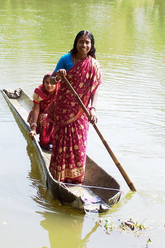 Women in a boat, Bangladesh. Photo by WorldFish, 2004