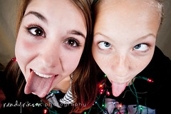 being silly (randyr photography) Tags: christmas girls friends silly tongue zeiss lights crosseye sony teens alpha a850 sal1635z
