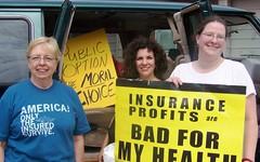 Sue Dinsdale, Iowa Main Street Alliance organizer, on left and Amy Logsdon, Iowa Citizen Action Network organizer, on right.