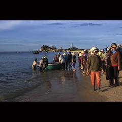 Ke Ga beach in the morning (-clicking-) Tags: ocean life lighting morning light sea sky people sun sunlight lighthouse beach water sunshine clouds asia onthebeach waves streetphotography streetlife vietnam phanthit kg