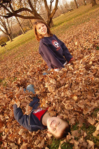 Hannah and Harrison Playing In The Leaves