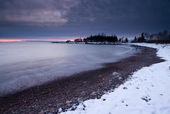 Sugarloaf Cove (Bryan Hansel) Tags: longexposure pink winter red usa snow beach sunrise waves purple cobblestone mn lakesuperior tombolo sugarloafcove galesofnovemberworkshop