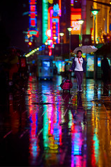 Lost Schoolgirl (Jonathan Kos-Read) Tags: china storm rain umbrella reflections lost neon alone shanghai chinese luggage lonely    schoolgirl raining puddles bigcity schooluniform  nanjingroad vulnerable goldenratio    chinesegirl      atx828afpro chineseschoolgirl tokinaaf80200mmf28 tokina80200matxprof28