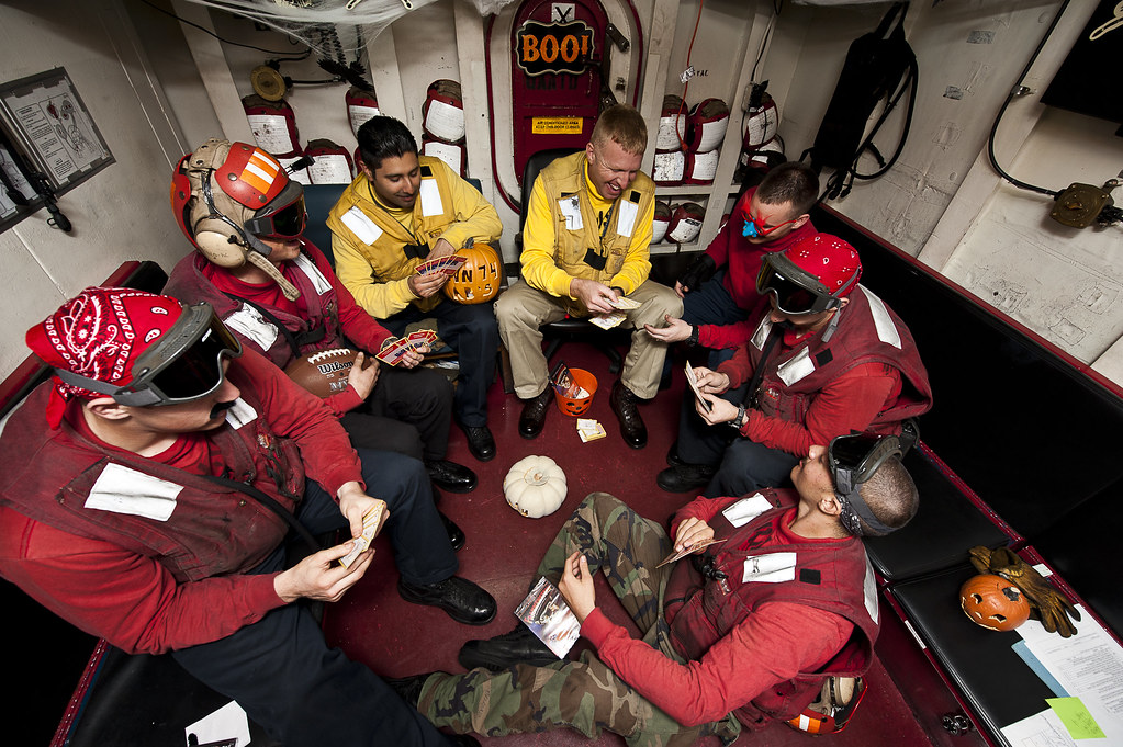 Sailors play with Halloween decorations and cards supplied by the USO.