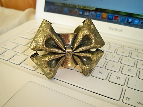 Claires Icing Gold Bow Bracelet