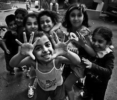 happy kids in the streets of istanbul // tarlaba, istanbul (pamela ross) Tags: street smile face kids pen turkey fun happy hands olympus istanbul ep1 tarlabasi tarlaba istanbullovers tarbalasi