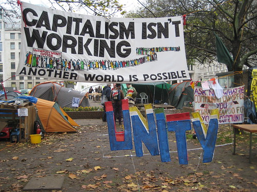 Tents and a sign reading 'capitalism isn't working'