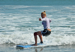 The Girl on an invisible chair (artMart_maker) Tags: ocean sea summer bali man beach water girl sport indonesia fun coast seaside surf board extreme indianocean wave sunny surfing surfschool surfboard tropical watersports active kuta surfzone
