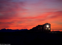 Sunset in the desert (DWHonan) Tags: california ca railroad sunset electric train track desert rail railway trains junction needles arrowhead bnsf railroads powerhouse subdivision intermodal jct redskies stacktrain dieselelectricorelectrictrains
