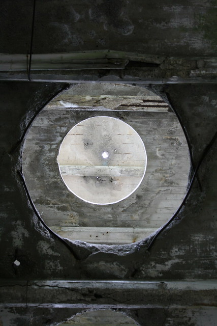 The circles get smaller in each floor above, until the roof, where the circles are as small as a hole on the green of the abandoned White's Mini Golf in Wasaga Beach.