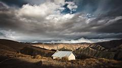 Clouds are a 'rollin' (elbeardo) Tags: blue newzealand sky cloud mountains shadows dramatic hike hut rolling sod