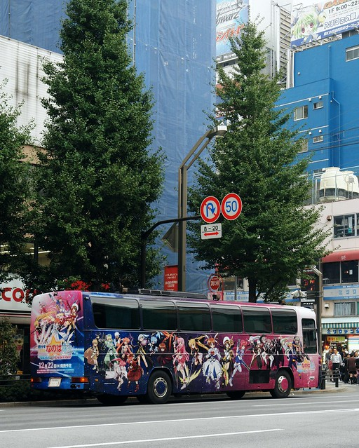 "Wrapping BUS with LCD monitors ""Magical girl lyrical Nanoha A's PORTABLE -THE GEARS OF DESTINY"" in Akihabara main street."