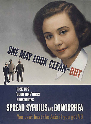 Poster with an image of a white woman with brown hair that reads She may look clean but pick up girls, good time girls, prostitutes, SPREAD SYPHILIS AND GONORRHEA. Below the words are three soldiers, and the text at the bottom says you can't beat the Axis if you get VD