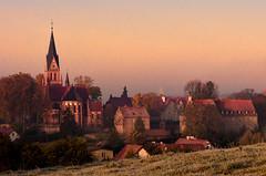 Gietrzwałd in the sunrise (warmianaturalnie) Tags: church sunrise town warmia gietrzwałd