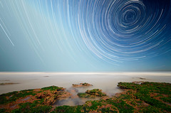 All Around South (lrargerich) Tags: ocean longexposure sea sky seascape beach water rock night stars rocks nightscape south trails pole explore round around celestial startrails 3hours