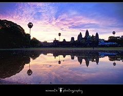 as the sun rises, so does the splendor (PNike (Prashanth Naik..back after ages)) Tags: blue trees sky sun reflection water architecture clouds sunrise temple nikon asia cambodia purple angkorwat structure siemreap angkor wat d7000 momentsphotography pnike