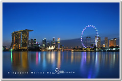 Singapore (fiftymm99) Tags: bridge reflection building tree water wheel by museum modern skyscraper marina river garden lights one restaurant hotel bay pier flyer nikon singapore waterfront ceremony may bank casino tourists business opening cbd clifford standard coconuts fullerton turning biggest ntuc rooftopgarden d300 marinabay uob charted helixbridge artscience marinabaysands attarction fiftymm99 gettyimagessingaporeq2