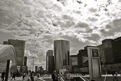 La Dfense, Paris (Nadialeesi) Tags: light sky blackandwhite bw sun sunlight paris france clouds canon buildings eos ladfense 1000d