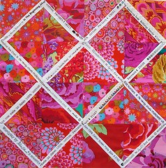 Selvedge strips and red Philip Jacobs and Kaffe Fassett fabrics (Cottilello) Tags: flowers red floral westminster square triangle quilt panel pillow fabric half quilted jacobs rowan cushion philip kaffe fibers selvage fassett selvedge