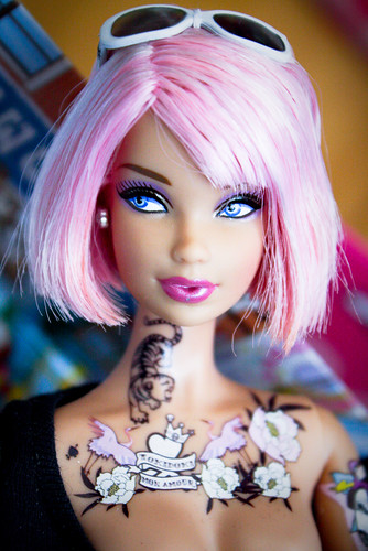 to have tattoos? Barbie