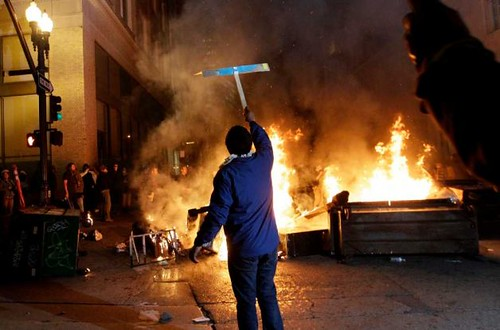 Bonfires burn in downtown Oakland in the aftermath of a general strike on November 2, 2011. The strike mobilized thousands to oppose police repression and capitalist exploitation. by Pan-African News Wire File Photos