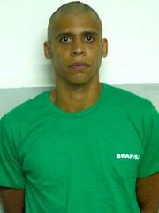 Governo do Rio de Janeiro divulgou foto de Nem com o cabelo raspado e uniforme do presídio de Bangu. Foto: SEAP