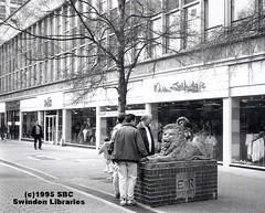 1995: Golden Lion - Canal Walk, Swindon (Local Studies, Swindon Central Library) Tags: bw statue swindon publicart 1995 sbc wiltshire 1990s towncentre goldenlion canalwalk missselfridge phootgraph carletonattwood