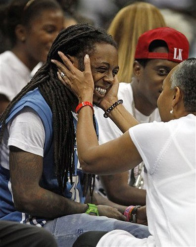lil wayne wearing a SEIMONE AUGUSTUS jersey at the wnba finals