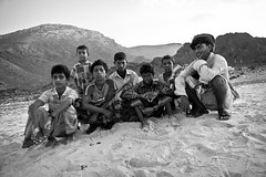 little boys on the beach of Socotra island-yemen (anthony pappone photography) Tags: travel portrait people beach boys digital canon pose children island photography photo foto faces image expression retrato picture culture unesco arab portraiture arabia adan yemen arabian fotografia bottletree ritratto reportage photograher phototravel yaman socotra soqotra arabie childrentravel arabiafelix portraitsofchildren eos5dmarkii dragonsbloodtrees
