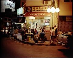Happy corner at midnight (Padungan, 2011) (Eye Sarawak) Tags: kodak sarawak nightview kuching jobo mamiya7ii flexicolor jobocpa