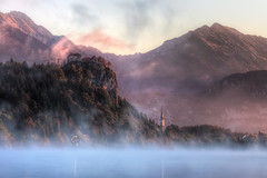 Bled Castle (TheFella) Tags: longexposure pink blue trees cliff mist lake snow mountains alps slr castle church fog clouds digital photoshop sunrise canon landscape eos dawn photo high warm europe dynamic stmartin glacier snowcapped slovenia photograph processing slowshutter bled 5d slovenija balkans peaks dslr grad range 75300 hdr highdynamicrange balkan markii postprocessing lakebled stmartinschurch glaciallake julianalps slovene habsburg bledcastle blejskigrad photomatix republikaslovenija blejskojezero thefella 5dmarkii republicofslovenia stmartina conormacneill thefellaphotography cerkevsvetegamartina northbalkans lpmystical