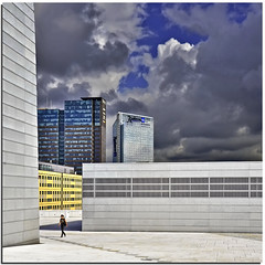 Alone over the Opera (Nespyxel) Tags: light sky woman oslo norway architecture modern clouds contrast buildings donna nuvole alone skyscrapers cielo s