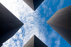 Looking Up from within the Holocaust Memorial (gomattolson) Tags: blue sky berlin germany europe holocaustmemorial xmarksthespot