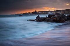 Inside the storm - Aci Castello (Mark Phillip) Tags: sunset sea italy storm rain weather bag nikon italia tramonto mare waves d70 tripod bad plastic cover sicily nikkor pioggia castello tempo mal catania aci trezza manfrotto onde tempesta acitrezza 1870 siclia acicastello 055xprob