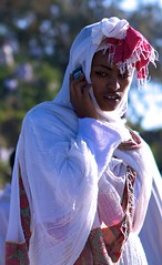 Veiled Ethiopian girl phoning, True cross ceremony - Mount Abuna Yoseph, Lalibela, Ethiopia (Alex_Saurel) Tags: africa trip travel portrait woman girl beautiful beauty female veiled veil femme religion ceremony traditions naturallight christian portraiture ethiopia abyssinian orthodox fille voile lalibela afrique christianism etiopia beaute abyssinia lalibella mignonne portray ethiopie christianisme traditionalclothes abyssinie abisinia etiopija habesistan 埃塞俄比亚 etiopien 埃塞俄比亞 abissinia אַביסיניע abessinien etiyopya אתיופיה fêtes cérémonie эфиопия етиопия абиссиния lumièrenaturelle етиопија 衣索匹亚 衣索匹亞 voilée 85mmf28sam äthiopien ethiopië etiopía etiópia αιθιοπία 에티오피아 이디오피아 エチオピア اتیوپی αβυσσινία