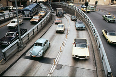 1960s and 1970s car heaven. I spy a 1960s Chevy Impala, a 1971 Camaro, a Chevy Nova, a Datsun (?), Cadillac, a GMC Flxible bus, a 1960s Dodge Van and lots of VW Beetles.  What do U see? Brooklyn Battery Tunnel traffic. New York. March 1973 (wavz13) Tags: vintagecar kodachrome oldphotographs oldcar oldphotos oldcars oldnewyork vintagecars instamatic oldslides vintagephotos collectablecars collectiblecars vintagenewyork 1960scars vintageslides 1970sphotos 1970sphoto kodachromeslides 1970scars 1970scar oldmanhattan 1970sphotographs vintagemanhattan 1970snewyork 1970sslides