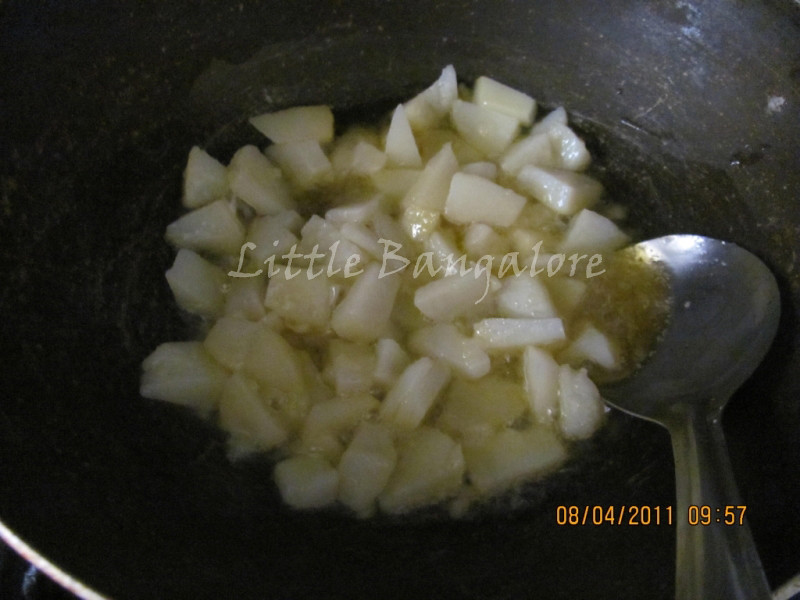 Potatoes pieces while frying