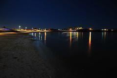 Dark sand - Bright lights (Mark Youlden) Tags: ocean uk sea sky beach water dark stars sand nikon waves stones pebbles anglesey nught d300s