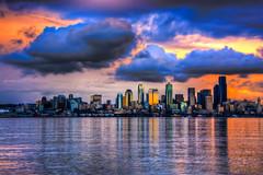Seattle Skyline under a Brilliant Sunset (AlexKrengel) Tags: seattle sunset water skyline clouds skyscape 50mm bay harbor washington nikon alki westseattle wa pugetsound hdr cloudscape elliotbay d90 alexkrengel