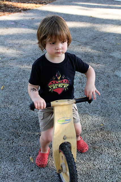 Silas riding a balance bike