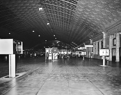 Washington Union Station concourse area located between the platform tracks and the main waiting room, June 1976 (alcomike43) Tags: old people blackandwhite bw building classic station vintage washingtondc photo doors interior terminal historic negative photograph depot travelers commuters concourse washingtonunionstation mainwaitingroom
