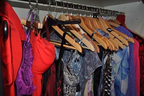 colorful dresses and clothes in the closet