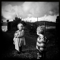 The girl next door. (angus clyne) Tags: road door travel autumn light boy two portrait cloud sun white house black eye fall girl face rain mobile wall contrast rural forest cat garden hair toy drive scotland gate doll shine child play jcb time angus head path small country rosie hill grain perthshire young scottish super glen plastic blond perth ear half timeless digger torin iphone thegirlnextdoor hipstamatic