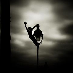 Rue de la Victoire (Christine Lebrasseur) Tags: street people blackandwhite man paris france art 6x6 lamp silhouette sport sepia architecture canon skyscape football body montmartre acrobat fr iledefrance lanscape 500x500 basiliquedusacrécœur challengeyouwinner ltytrx5 ltytr1 allrightsreservedchristinelebrasseur herowinner 2112011 landscapeseascapeskyscapeorcityscape