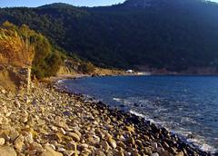 Glyfada beach,Rodi (silvia07(very busy)) Tags: blue sea beach sand mediterraneo mare stones olympus greece pietre grecia colori rhodes spiaggia rodi vacanze mediterraneansea sabbia egeo aegeansea