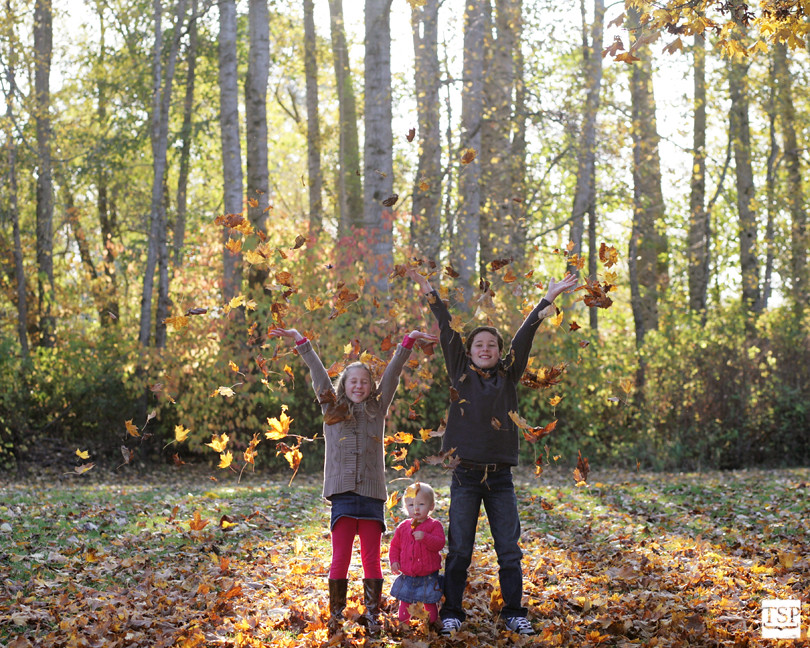 Kids Throwing Leaves