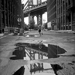 puddles tell the story (Barry Yanowitz) Tags: nyc newyorkcity bridge blackandwhite bw ny newyork reflection 6x6 film water brooklyn mediumformat reflections puddle blackwhite kodak trix dumbo bridges 120film d76 manhattanbridge scanned gothamist filmcamera puddles nycity selfdeveloped 718 kodaktrix400 downunderthemanhattanbridgeoverpass rolleicordv selfdeveloping d76developer nprfilm