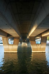 Under Courbevoie bridge (Sokleine) Tags: bridge light france water seine reflections river lumire pont reflets dessous 92 fleuve hautsdeseine neuillysurseine